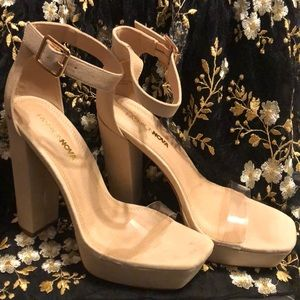 Heeled beige sandals with PVC strap.